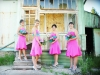 Bridesmaids in front of historic ghost town buildings of Southern Cross